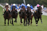 Paul Hanagan riding Thikriyaat (C, blue) win The Bonhams Thoroughbred Stakes from Forge (R) at Goodwood on July 29, 2016 in Chichester, England.