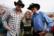 Singer Trace Adkins and team owner Richard Petty pose with Miss Sprint Jaclyn Roney prior to the NASCAR Sprint Cup Series Goody's Fast Relief 500 at Martinsville Speedway on April 1, 2012 in Martinsville, Virginia.