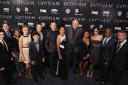 "(L-R) Robin Lord Taylor, Donal Logue, Camren Bicondova, Erin Richards, David Mazouz, Ben McKenzie, Cory Michael Smith, Zabryna Guevara, John Doman, Jada Pinkett Smith, Victoria Cartagena, Andrew Stewart-Jones, and Sean Pertwee attend the ""Gotham"" series premiere at The New York Public Library on September 15, 2014 in New York City."