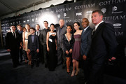 (L-R) Robin Lord Taylor, Donal Logue, Camren Bicondova, Erin Richards, David Mazouz, Ben McKenzie, Cory Michael Smith, Zabryna Guevara, John Doman, Jada Pinkett Smith, Victoria Cartagena, Andrew Stewart-Jones, and Sean Pertwee attend the GOTHAM Series Premiere event on September 15, 2014 in New York City.