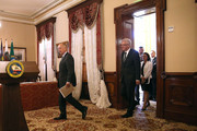 California Gov. Jerry Brown (L) arrives with Winfried Kretschmann, (R) Minister-President of the German state of Baden-Wurttemberg, during a bill signing event at the Leland Stanford Mansion on May 19, 2015 in Sacramento, California.  Gov. Brown signed a first-of-its-kind agreement with leaders from 11 states and international provinces to limit the increase in global average temperature to below 2 degrees Celsius.