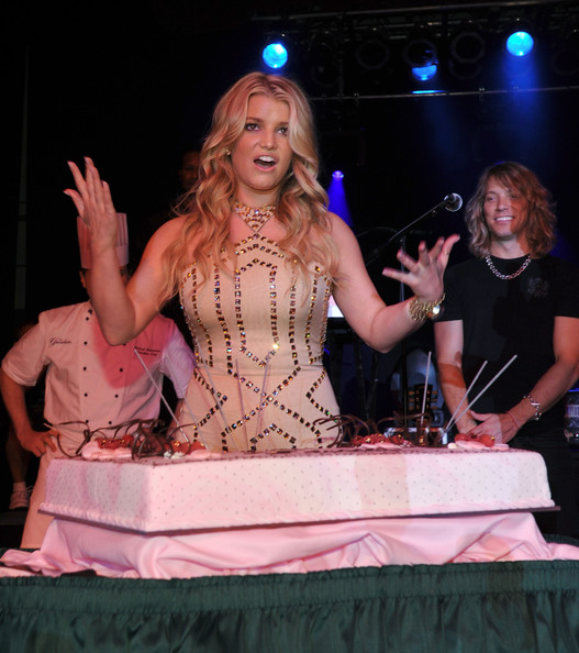 Jessica Simpson Singer and actress Jessica Simpson poses with a birthday cake at the grand opening of the Casino Club at The Greenbrier on July 2, 2010 in White Sulphur Springs, West Virginia.