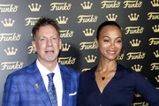 Brian Mariotti and Zoe Saldana attend the grand opening of Funko Hollywood at Funko Hollywood Store on November 07, 2019 in Hollywood, California.