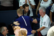 Kyle Edmund of Great Britain is congratulated by Andy Murray after winning match point during his quarter final match against Philipp Kohlschreiber of Germany on Day Five of the 2019 Davis Cup at La Caja Magica on November 22, 2019 in Madrid, Spain.