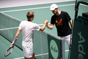Andy Murray of Great Britain shakes hands with Dan Evans during a practice session ahead of his quarter final match on Day Five of the 2019 Davis Cup at La Caja Magica on November 22, 2019 in Madrid, Spain.