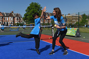 Former British No. 1 Tennis player Annabel Croft high fives with a young tennis fan from Heathbrook Primary School as they launch the Great British Tennis Weekend at Clapham Common on May 13, 2015 in London, England.