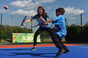 Former British No. 1 Tennis player Annabel Croft in action with a young tennis fan from Heathbrook Primary School as they launch the Great British Tennis Weekend at Clapham Common on May 13, 2015 in London, England.