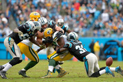 Charles Tillman #31 of the Carolina Panthers forces a fumble by Eddie Lacy #27 of the Green Bay Packers during their game at Bank of America Stadium on November 8, 2015 in Charlotte, North Carolina.