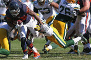 Ka'Deem Carey #25 of the Chicago Bears breaks away from Jarrett Bush #24 of the Green Bay Packers at Soldier Field on September 28, 2014 in Chicago, Illinois. The Packers defeated the Bears 38-17.