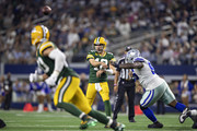 Aaron Rodgers #12 of the Green Bay Packers throws a pass to Jimmy Graham #80 during a game against the Dallas Cowboys at AT&T Stadium on October 6, 2019 in Arlington, Texas.  The Packers defeated the Cowboys 34-24.