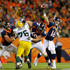 Peyton Manning Photos - Quarterback Peyton Manning #18 of the Denver Broncos throws a pass in the fourth quarter against the Green Bay Packers at Sports Authority Field at Mile High on November 1, 2015 in Denver, Colorado. The Broncos won 29-10. - Green Bay Packers v Denver Broncos