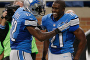 Reggie Bush #21 and Jeremy Ross #12 of the Detroit Lions celebrate while playing the Green Bay Packers at Ford Field on September 21, 2014 in Detroit, Michigan the lions win 19-7.