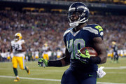 Fullback Derrick Coleman #40 of the Seattle Seahawks celebrates after scoring a touchdown in the fourth quarter of the game against the Green Bay Packers at CenturyLink Field on September 4, 2014 in Seattle, Washington.