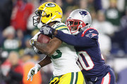 Jason McCourty #30 of the New England Patriots tackles Marquez Valdes-Scantling #83 of the Green Bay Packers during the second half at Gillette Stadium on November 4, 2018 in Foxborough, Massachusetts.