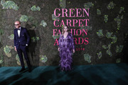 This image has been altered with digtal filter )  Marco Bizzarri and Hari Nef attend the Green Carpet Fashion Awards at Teatro Alla Scala on September 23, 2018 in Milan, Italy.