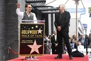 Chef Guy Fieri (R)  looks on as actor Matthew McConaughey (L) speaks during Guy Fieri's Hollywood Walk of Fame Star ceremony, California.