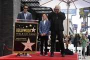(L-R) Hunter Fieri and Ryder Fieri with their farther Chef Guy Fieri who was honored with the 2,664th Star on the Hollywood Walk of Fame Star, in Hollywood, California.