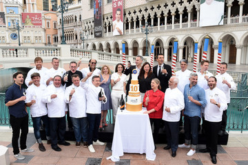 Guy Savoy Chef Daniel Boulud Sabers Off A Bottle of Prosecco Celebrating Vegas Uncork'd By Bon Appetit's 10th Anniversary