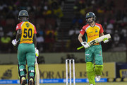 In this handout image provided by CPL T20, Sherfane Rutherford (L) and Shoaib Malik (R) of Guyana Amazon Warriors partnership during match 6 of the Hero Caribbean Premier League match between Guyana Amazon Warriors and Barbados Tridents at Guyana National Stadium on August 12, 2018 in Providence, Guyana.