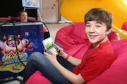 "In this photo provided by Nintendo of America,  Benjamin Stockham from ""About a Boy"" attends the Kirby: Planet Robobot event celebrating the games launch at Smashbox Studios in Culver City, California, on June 22, 2016. In this new action-packed adventure, Kirby gets new abilities and transformations, such as flamethrower arms and buzz-saw hands."