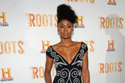 """Actress Emayatzy Corinealdi attends the premiere screening of """"Night One"""" of the four night epic event series, """"Roots,"""" hosted by HISTORY at Alice Tully Hall on May 23, 2016 in New York City."""