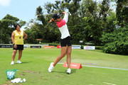 Tiffany Chan of Hong Kong practices on the range as Nancy Lopez looks on prior to the HSBC Women's World Championship at Sentosa Golf Club on February 28, 2018 in Singapore.