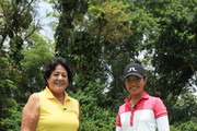 Tiffany Chan of Hong Kong and Nancy Lopez pose on the range on prior to the HSBC Women's World Championship at Sentosa Golf Club on February 28, 2018 in Singapore.