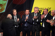 Uwe Seeler is congratulates by Guenter Netzer, Lothar Matthaeus, Sepp Maier, Andreas Brehme, Franz Beckenbauer and Paul Breitner on stage the Hall Of Fame gala at Deutsches Fussballmuseum on April 01, 2019 in Dortmund, Germany.