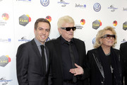 Philipp Lahm, Heino and his wife Hannelore Kramm attend the Hall Of Fame gala at Deutsches Fussballmuseum on April 01, 2019 in Dortmund, Germany.