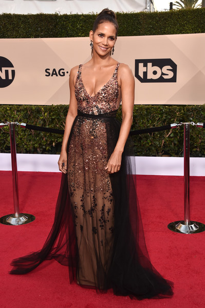 24th Annual Screen Actors Guild Awards - Arrivals [red carpet,carpet,dress,clothing,shoulder,gown,hairstyle,fashion model,flooring,fashion,arrivals,halle berry,screen actors guild awards,los angeles,california,the shrine auditorium]