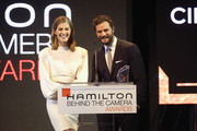 Rosamund Pike  and Jamie Dornan speak onstage at the Hamilton Behind the Camera Awards presented by Los Angeles Confidential Magazine on November 4, 2018 in Los Angeles, California.  (Photo by Phillip Faraone/Getty Images for LA Confidential)