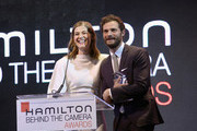Rosamund Pike  and Jamie Dornan speak onstage at the Hamilton Behind the Camera Awards presented by Los Angeles Confidential Magazine on November 4, 2018 in Los Angeles, California.