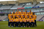 (Back Row) Adam Wheater, Joe Gatting, William Smith, Sean Terry, Michael Bates, (Middle Row) Tom Barber, Ruel Brathwaite, David Balcombe, James Tomlinson, Christopher Wood, Matthew Coles, Lewis McManus, (Front Row) Liam Dawson, Michael Carberry, Jimmy Adams, James Vince, Sean Ervine and Daniel Briggs pose for the camera's in their T20 kit during the Hampshire CCC Photcall at the Ageas Bowl on April 3, 2014 in Southampton, England.