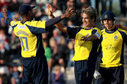 Imran Tahir of Hampshire celebrates a wicket with Dimitri Mascarenhas during the Friends Life T20 Quarter Final match between Hampshire and Durham at The Rose Bowl on August 7, 2011 in Southampton, England.