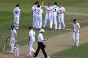 Jimmy Adams and James Tomlinson of Hampshire (2nd R) celebrate taking the wicket of Paul Collingwood of Durham with their team mates during the LV County Championship match between Hampshire and Durham at Ageas Bowl on July 19, 2015 in Southampton, England.