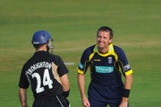 Dominic Cork of Hampshire shares a joke with Jim Troughton of Warwickshire during the Clydesdale Bank 40 match between Hampshire and Warwickshire at The Rose Bowl on April 24, 2011 in Southampton, England.