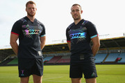 Mike Brown and George Merrick of Harlequins pose wearing the new Harlequins 2018/19 Charity Jersey Quintessential Flash at Twickenham Stoop on September 14, 2018 in London, England. The industry-first kit, developed by adidas rugby and to be worn at Big Game 11, uses technology taken from reflective foils normally seen in running and cycling apparel and £5 of each shirt purchase will go to the Harlequins Foundation.