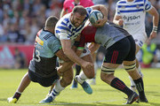 Jamie Roberts of Bath Rugby tackled by Joe Marchant (l) and Chris Robshaw of Harlequins during the Gallagher Premiership Rugby match between Harlequins and Bath Rugby at Twickenham Stoop on September 15, 2018 in London, United Kingdom.