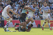 Jamie Roberts of Bath Rugby tackled by Elia Elia (l) and Ben Tapuai of Harlequins during the Gallagher Premiership Rugby match between Harlequins and Bath Rugby at Twickenham Stoop on September 15, 2018 in London, United Kingdom.