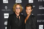 """Peter Dundas (L) and Evangelo Bousis attends as Harper's BAZAAR Celebrates """"ICONS By Carine Roitfeld"""" at the Plaza Hotel on September 7, 2018 in New York City."""