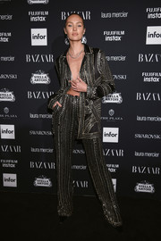 Candice Swanepoel made a bold statement with this heavily studded pantsuit worn sans shirt at the Harper's Bazaar Icons event.