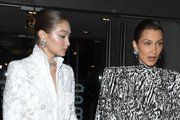 (EDITORIAL USE ONLY) (L to R) Gigi Hadid and Bella Hadid attend the Harper's Bazaar Exhibition as part of the Paris Fashion Week Womenswear Fall/Winter 2020/2021 At Musee Des Arts Decoratifs on February 26, 2020 in Paris, France.