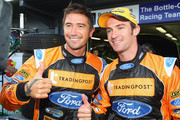 Harry Kewell of the Melbourne Victory A-League team poses with Ford Performance Racing Team driver Will Davison at the L&H 500 for round nine of the V8 Supercar Championship Series at Phillip Island Grand Prix Circuit on September 18, 2011 in Phillip Island, Australia.