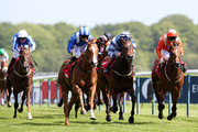 Mutarakez ridden by Paul Hanagan (Royal Blue and White striped caps) wins the Betfred Mobile Silver Bowl Stakes at Haydock racecourse on May 23, 2015 in Haydock, England.
