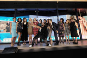 Savion Glover (Center front)  takes a selfie with (L-R), Sade Baderinwa, Herizen Guardiola, Mandy Moore, Sandra Lee, Hannah Storm,  Shiri Appleby, Constance Zimmer, Soledad O'Brien, Mehmet Oz, Lisa Oz, Jill Herzig and Nina Garcia during the Hearst launch of HearstLive, a multimedia news installation, at 57th Street & 8th Avenue on September 27, 2016 in New York City.