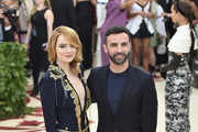 Actor Emma Stone and designer Nicolas Ghesquiere attend the Heavenly Bodies: Fashion & The Catholic Imagination Costume Institute Gala at The Metropolitan Museum of Art on May 7, 2018 in New York City.