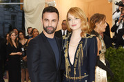Emma Stone and designer Nicolas Ghesquiere attends the Heavenly Bodies: Fashion & The Catholic Imagination Costume Institute Gala at The Metropolitan Museum of Art on May 7, 2018 in New York City.