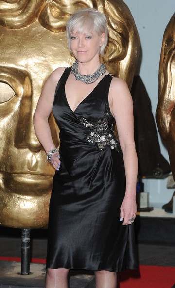 Celebs at the British Academy Games Awards [dress,clothing,cocktail dress,blond,hairstyle,little black dress,satin,fashion,carpet,fashion model,arrivals,helen chamberlain,british academy games awards,london hilton,england,the british academy games awards]