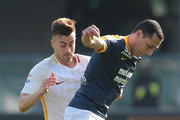 Romulo of Hellas Verona (front) competes for the ball with Stephan El Shaarawy of AS Roma during the serie A match between Hellas Verona FC and AS Roma at Stadio Marc'Antonio Bentegodi on February 4, 2018 in Verona, Italy.