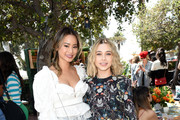 Jamie Chung and Olesya Rulin attend the Henri Bendel Surf Sport 2018 Collection Launch at The Bungalow on April 27, 2018 in Santa Monica, California.